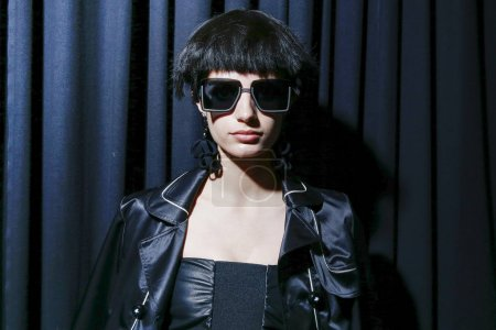 MILAN, ITALY - SEPTEMBER 22: A model is seen backstage ahead of the Giorgio Armani show during Milan Fashion Week Spring/Summer 2018 on September 22, 2017 in Milan, Italy.