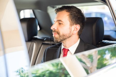 businessman going by  taxi cab to work