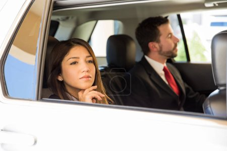 Businesswoman sitting in the backseat
