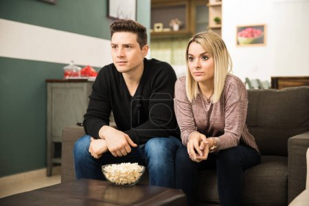 Young couple watching a thriller