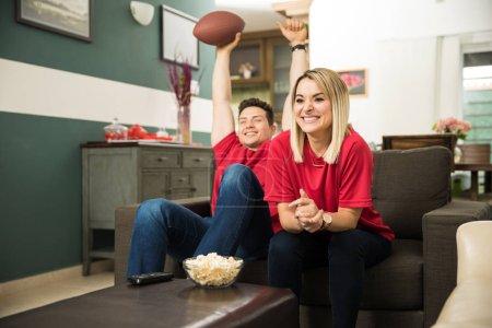 Couple celebrating a touchdown