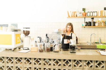 Cute barista in coffee shop