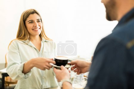 Woman buying cup of coffee