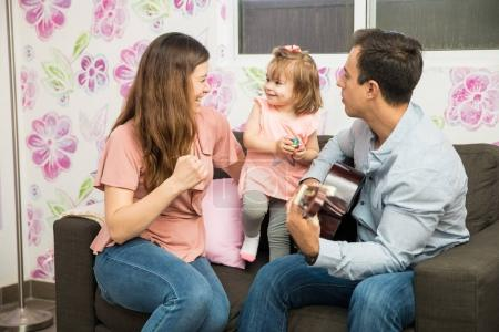 Family singing while father playing