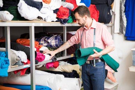 Designer looking at different fabrics