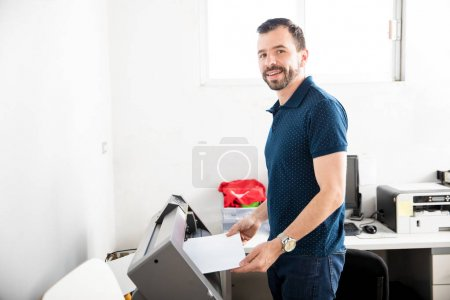 Handsome man printing labels