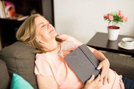 Woman falling asleep with book
