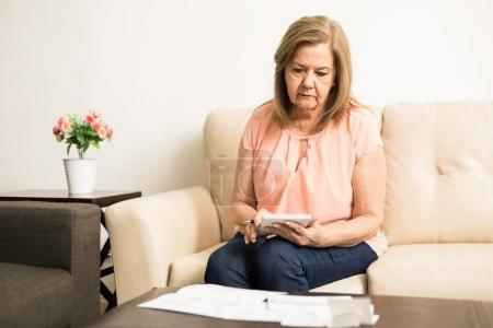 Elder lady checking personal finances
