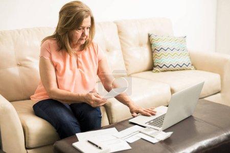 Woman doing taxes on laptop