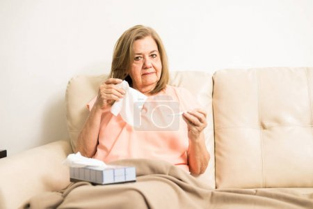 Aged lady holding tissue