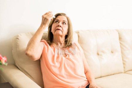 Aged lady taking care of eyes