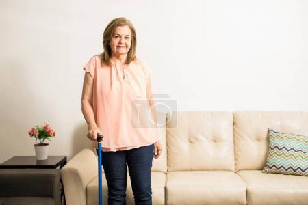 Aged granny using blue singlestick