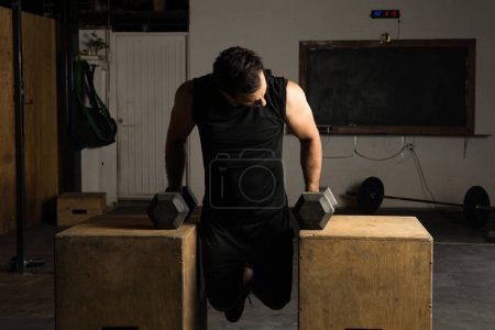 Man working on his arms in a gym