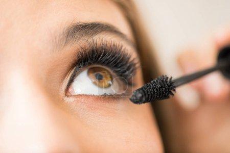 woman eye getting some mascara