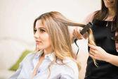 female customer with hair iron