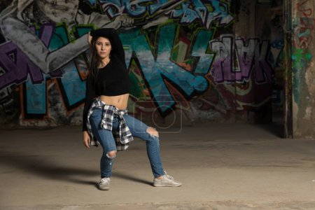 Female urban dancer trying out some moves