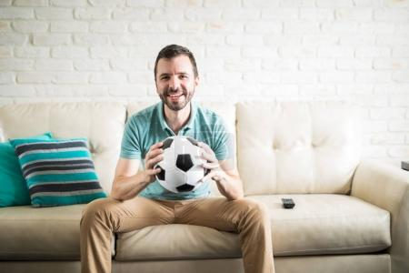 man holding soccer football ball