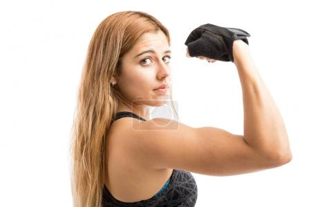 Hispanic woman showing strength