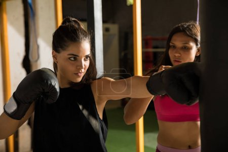 Pretty woman training in a boxing gym