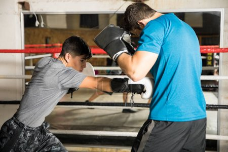 Shorter boxer beating a bigger man