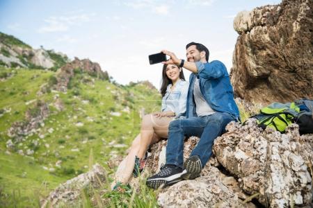 Cute couple taking a selfie