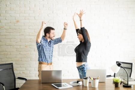 Work partners celebrating good news