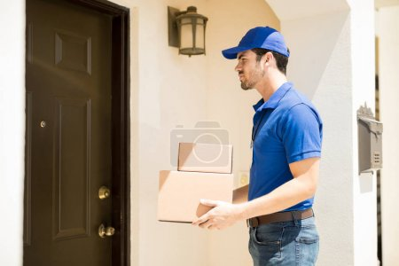 Delivery guy outside a house