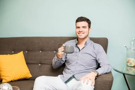 Young man drinking some coffee