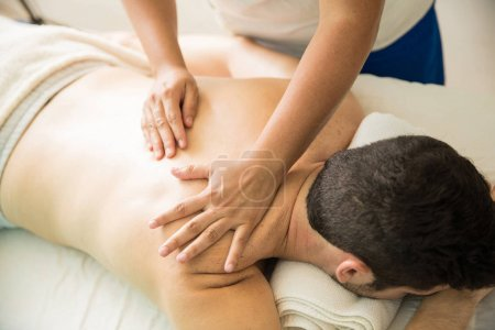 Getting a back rub in a spa