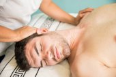 Relaxed man getting a neck massage
