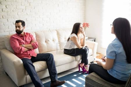 Hispanic couple in psychologist office