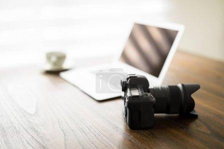 Professional camera on work desk
