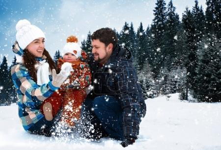 Attractive man, woman and child on a background of a Christmas