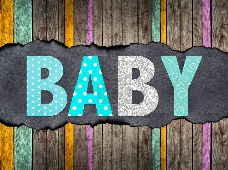 Photo pour Lettres de mot bébé sur un vieux fond en bois - image libre de droit