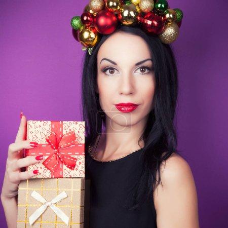 Woman wearing Christmas wreath