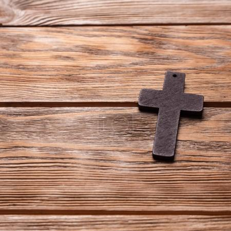Photo for Old cross on a brown wood background - Royalty Free Image