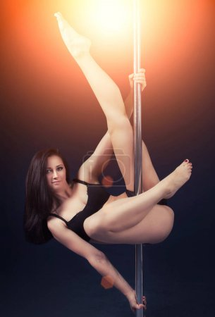young woman performing on pole