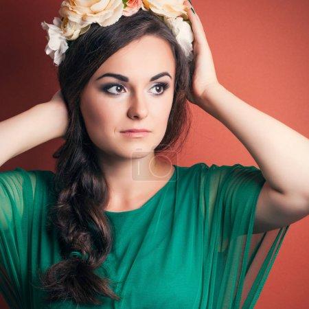 Beautiful young woman wearing wreath
