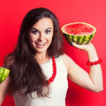beautiful young woman holding watermelon