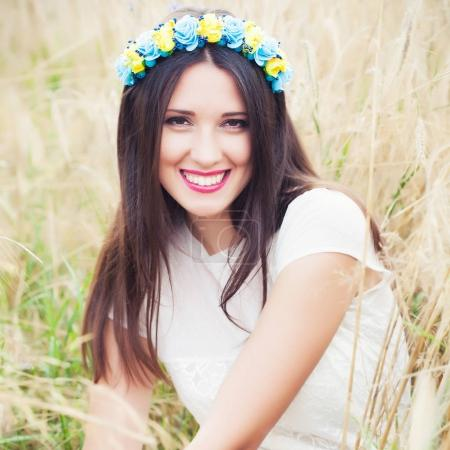 woman wearing blue and yellow wreath