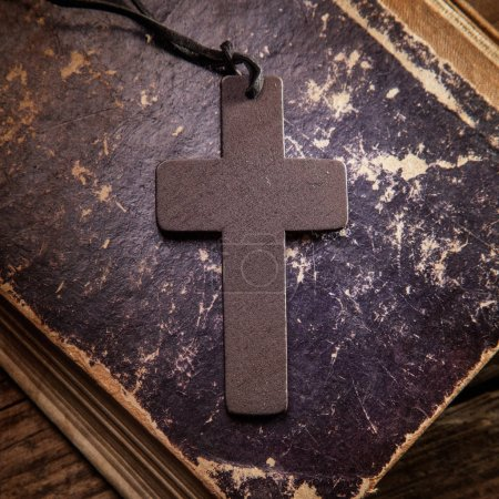 Photo for Closeup of wooden Christian cross on bible - Royalty Free Image