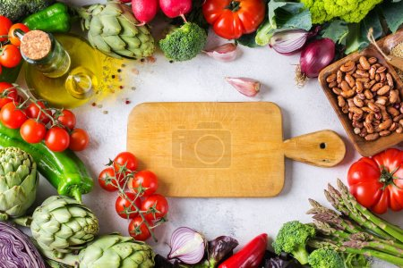 Photo for Assortment of fresh organic farmer market vegetables food for cooking vegan vegetarian diet and nutrition on a white table. Copy space background, top view, flat lay overhead - Royalty Free Image