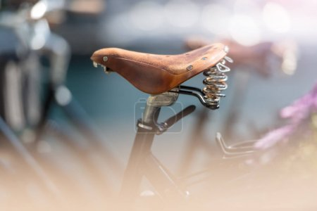 Bicycle saddle close up in street of Alesund