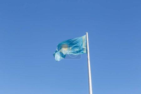 Republic of Kazakhstan flag on the flagpole. Karaganda, Kazakhst