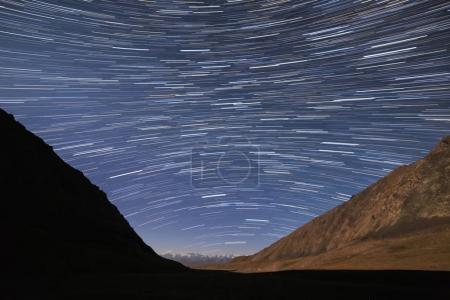 Traces of stars in the form of lines. View in the mountains. Kyr