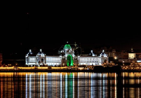 Russia, Kazan - August 19, 2017: Night view from the side of the Kazanka River to the Farmers' Palace (Ministry of Agriculture and Food)