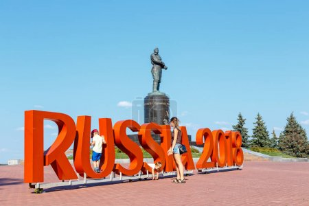 Russia, Nizhny Novgorod - August 22, 2017: Inscription Russia 2018 timed to 2018 FIFA World Cup in Russia against the background of the monument to the pilot Chkalov
