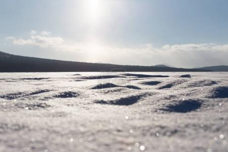 The texture of the snow, backlit, soft focus