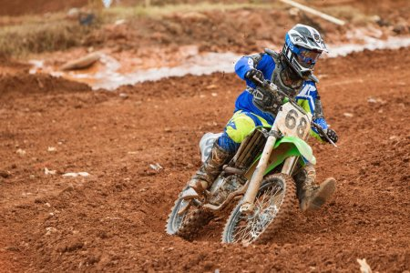 Rider Negotiates Turn At Muddy