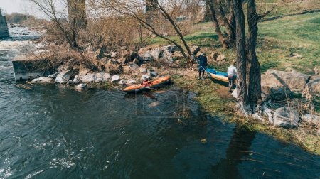 The river Ros. April 14, 2018. Deshki. Ukraine. People with kayaks on the shore. Aerial view.